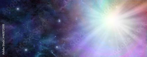 Photo Rainbow vortex massive light burst up in the heavens - dark blue night sky deep