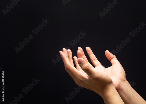 Fototapeta Praying hands in the dark background with faith in religion and belief in God