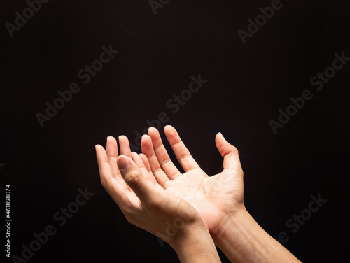 Fotografie, Obraz Praying hands in the dark background with faith in religion and belief in God