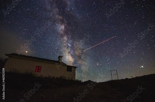 Fototapeta Milky Way rising over Prophet Ilias chapel in mountain Parnonas