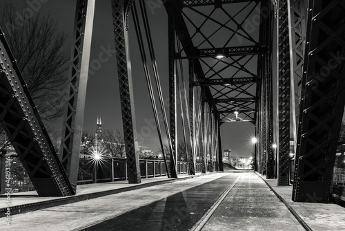Murais de parede Black and white night photograph from under the Cherry Avenue Z-2 asymmetric bob-tail railroad swing bridge looking towards the Chicago skyline