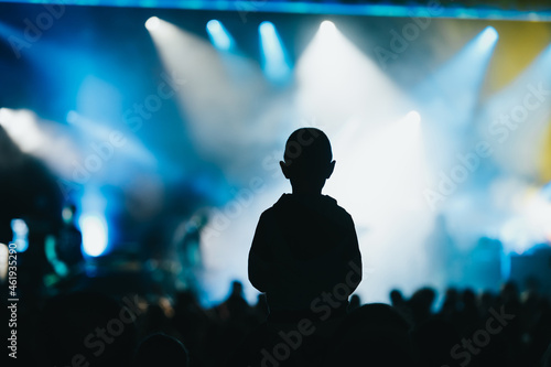 Slika na platnu Child in a audience crowd having fun and enjoying concert on a festival