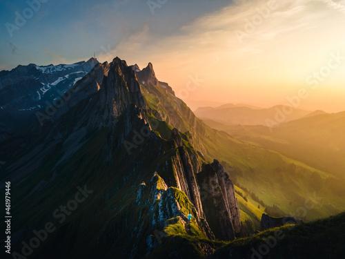 Wallpaper Mural Schaefler Switzerland, a couple walking hiking in mountains during sunset, man a