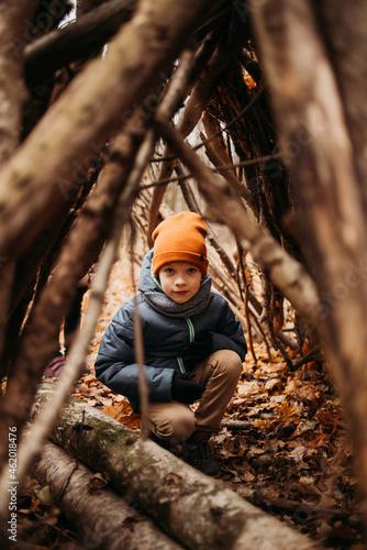 Fotografie, Obraz Lifestyle portrait boy in hut in autumn park fun walking