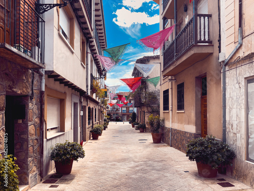 Spanish village street in the province of Avila decorated with shawls. Copy space.
