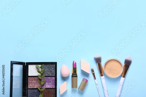 Stylish makeup sponges and decorative cosmetics on color background Fototapet