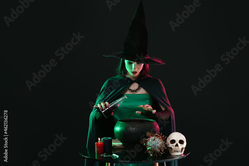 Fotografie, Obraz Witch performing ritual on black background