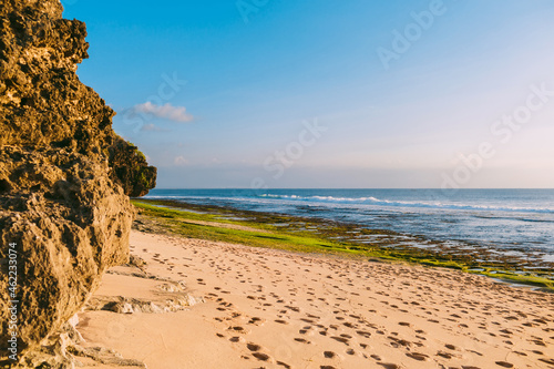 Wallpaper Mural Sandy beach with reef at low tide and ocean waves in Bali