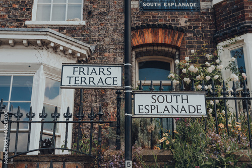 Fototapeta Street name signs on Friars Terrace and South Esplanade in York, UK