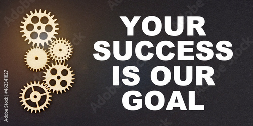 On a black background, gears and the inscription - Your Success is Our Goal