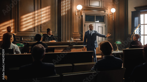 Photo Court of Law Trial in Session: Portrait of Charismatic Male Public Defender Making Touching, Passionate Speech to Judge and Jury