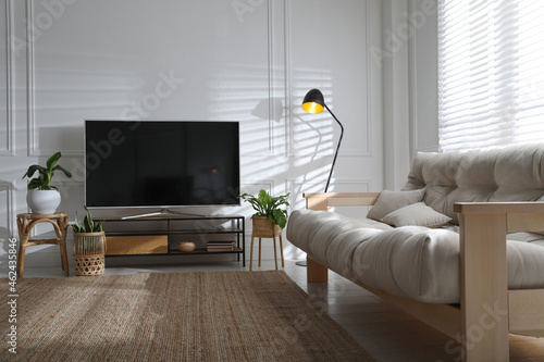 Living room interior with modern TV on stand
