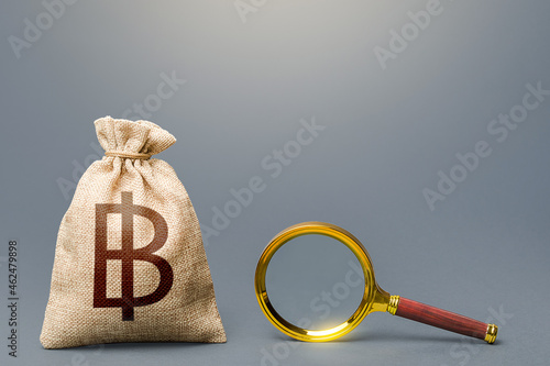 Fényképezés Thai baht money bag and magnifying glass