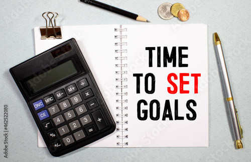 White notes with inscription 'time to set goals' and 'step 1, 2, 3' on beautiful black table, colored paper.