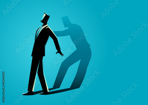 Obraz na plátně Businessman being pushed by his own shadow