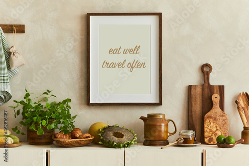 Stylish and modern kitchen interior composition with mock up poster frames, beige wooden sideboard, plants and retro inspired accessories. Template. Autumn vibes.