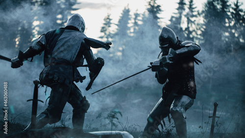 Fotografia Dark Age Battlefield: Two Armored Medieval Knights Fighting with Swords