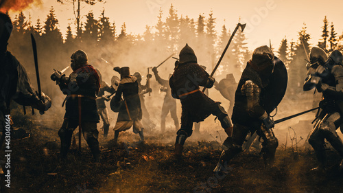 Fotografía Epic Battlefield: Two Armored Medieval Knights Fighting with Swords