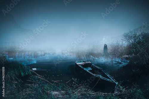 Photo Abandoned wooden boat on haunted lake shore with female ghost spirit emerging on it