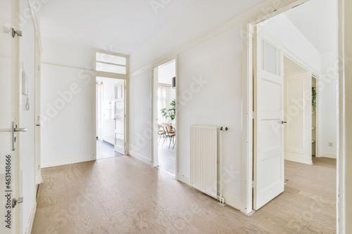 Obraz na plátně Spacious light corridor with doors wide open