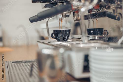 Canvastavla Professional coffee machine brewing espresso in cafe