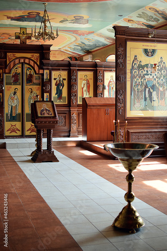 Fototapeta Day of the sacrament of the baptism of the baby baptismal font in the temple on