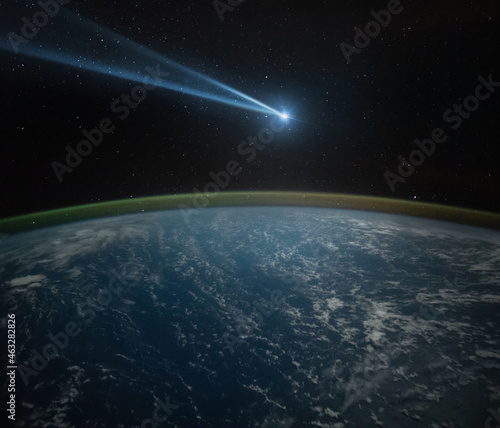 Photo Comet, asteroid, meteorite flying to the planet Earth