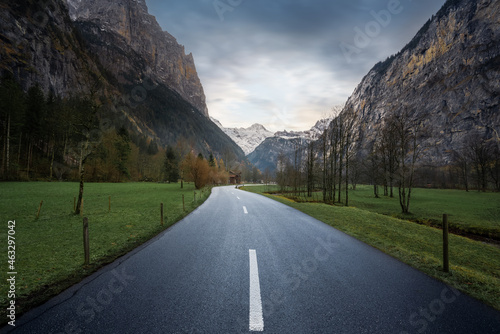 Road view leading straight into Bernese Alps Mountains - Lauterbrunnen, Switzerland.
