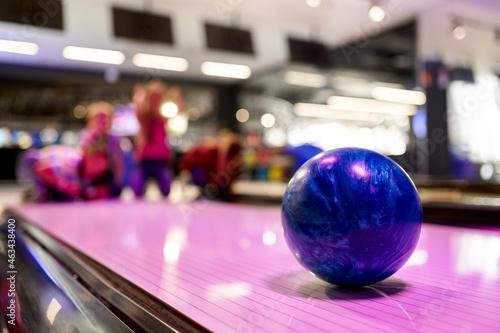 Ball on the lane, children in bowling alley Fototapeta
