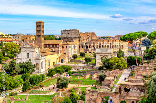 Fotografie, Obraz Aerial panoramic cityscape view of the Roman Forum and Roman Colosseum in Rome, Italy