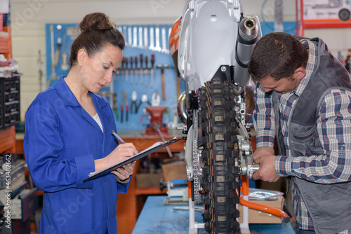 garage mechanics working on motorcycle
