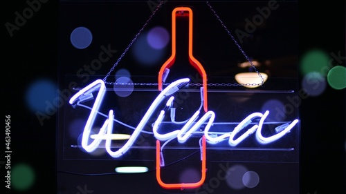 Glowing fragment of a neon sign, close-up, abstract background. Bokeh light flare.