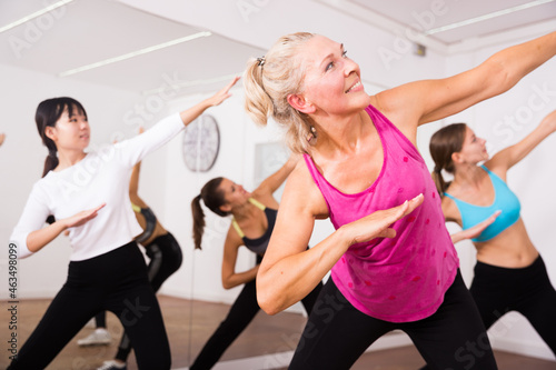 Cheerful different ages women learning swing steps at dance class Fototapeta
