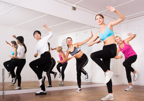 Slika na platnu Cheerful different ages women learning swing steps at dance class