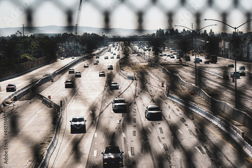 California freeway viewed from behind overpass fence #463514457