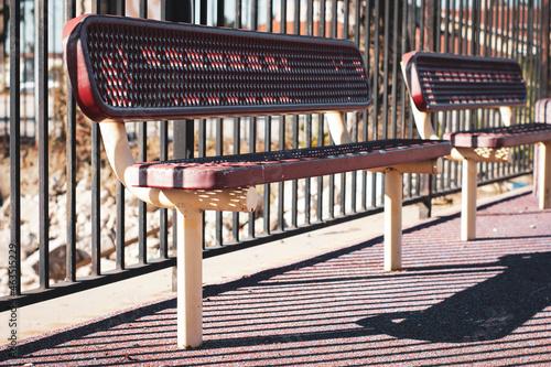 Metal bench in urban park #463515229