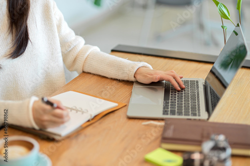 Female business owner using a laptop to analyze and plan her business model
