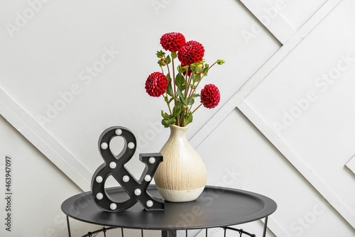 Vase with beautiful dahlia flowers on table