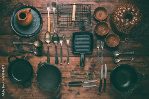 Foto Assortment of vintage kitchen utensils on wooden table